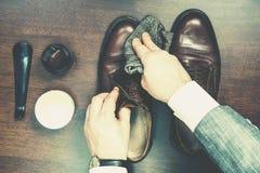 Polishing leather shoes Royalty Free Stock Images