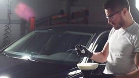 Polishing machine in garage. stock footage