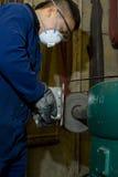 Polishing metal in workshop Royalty Free Stock Photos