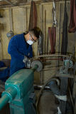 Polishing metal in workshop Royalty Free Stock Photography