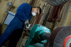 Polishing metal in workshop Stock Photos