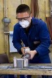 Polishing metal in workshop royalty free stock image