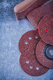 Polishing paper sanding discs abrasive flap wheels on metallic b Royalty Free Stock Photos