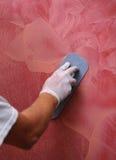 Polishing plastered walls Royalty Free Stock Images