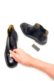 Polishing the shoes Royalty Free Stock Photo