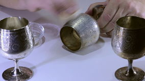 Polishing silver cup stock footage