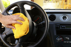 Polishing steering wheel Royalty Free Stock Photo