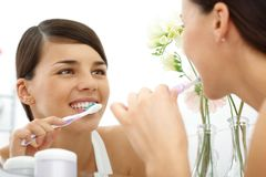 Polishing teeth Royalty Free Stock Images