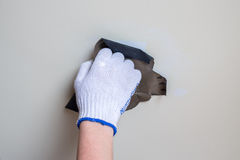 Polishing a wall with sandpaper closeup Royalty Free Stock Images
