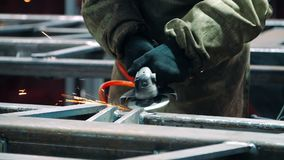 Polishing welding seams with angle grinder at plant. Using industrial instrument stock video footage