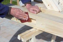 Polishing wooden beam Stock Photo
