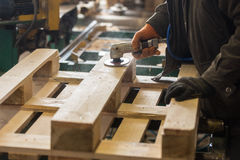 Polishing of a wooden pallet stock image