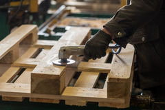 Polishing of a wooden pallet Stock Photo