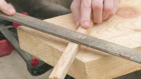 Polishing of wooden plank, close up stock footage