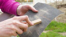 Polishing of wooden plank using glass-paper stock video