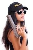 Poliskvinna med ett vapen Royaltyfri Fotografi