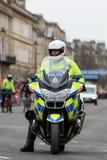 Polismotorcyletjänsteman, UK. Royaltyfria Bilder