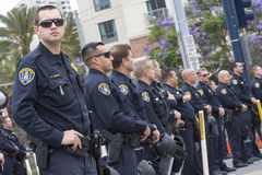 Polisnärvaro på trumf samlar Royaltyfri Bild