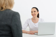 Polite doctor has discussion with senior lady Royalty Free Stock Image