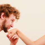Polite man kissing woman hand. Couple love. Royalty Free Stock Photo