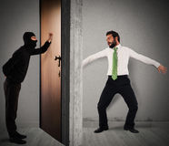 Polite thief. Thief knocks on the door of apartment Stock Images
