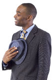 Politeness. Young black businessman being polite by taking hat off Stock Images