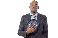 Politeness. Young black businessman being polite by taking hat off Stock Photography