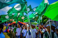 Politic assemble. A group of people assemble at the park to show their support for muslim candidate in government election in malaysia PAS royalty free stock photography