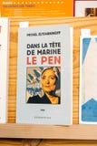 Political book in library store Dans la tete de Marine le Pen bo. PARIS, FRANCE - MAY 4, 2018: Dans la tete de Marine le Pen translated as In the head of Marine royalty free stock photo