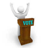 Political Candidate at Podium. A political candidate stands behind a podium with arms raised Stock Images
