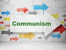 Political concept: arrow with Communism on grunge wall background. Political concept:  arrow with Communism on grunge textured concrete wall background, 3D Stock Images