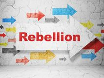 Political concept: arrow with Rebellion on grunge wall background. Political concept:  arrow with Rebellion on grunge textured concrete wall background, 3D Royalty Free Stock Images