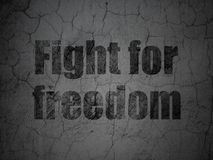 Political concept: Fight For Freedom on grunge wall background. Political concept: Black Fight For Freedom on grunge textured concrete wall background Royalty Free Stock Images