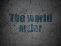 Political concept: The World Order on grunge wall background. Political concept: Blue The World Order on grunge textured concrete wall background Royalty Free Stock Photography
