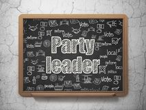 Political concept: Party Leader on School board background. Political concept: Chalk White text Party Leader on School board background with  Hand Drawn Politics Stock Image