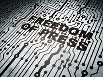 Political concept: circuit board with Freedom Of Press Royalty Free Stock Images