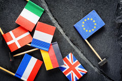 Political concept with flag of the European Union. EU. Flags of European countries separated by crack from flag of the European Union Royalty Free Stock Photo