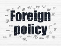 Political concept: Foreign Policy on wall background. Political concept: Painted black text Foreign Policy on White Brick wall background with  Hand Drawn Royalty Free Stock Image