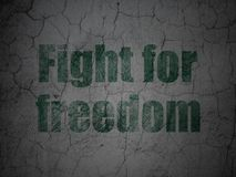 Political concept: Fight For Freedom on grunge wall background. Political concept: Green Fight For Freedom on grunge textured concrete wall background Stock Image