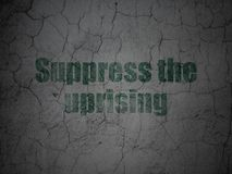 Political concept: Suppress The Uprising on grunge wall background. Political concept: Green Suppress The Uprising on grunge textured concrete wall background Royalty Free Stock Images