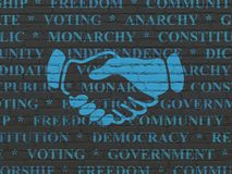 Political concept: Handshake on wall background. Political concept: Painted blue Handshake icon on Black Brick wall background with  Tag Cloud Royalty Free Stock Images