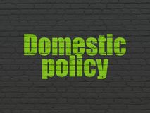 Political concept: Domestic Policy on wall background Stock Image