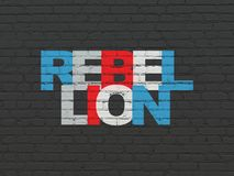 Political concept: Rebellion on wall background. Political concept: Painted multicolor text Rebellion on Black Brick wall background Royalty Free Stock Photography