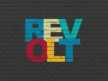 Political concept: Revolt on wall background. Political concept: Painted multicolor text Revolt on Black Brick wall background Stock Images
