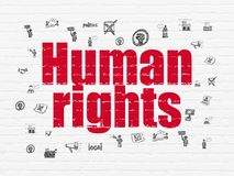 Political concept: Human Rights on wall background. Political concept: Painted red text Human Rights on White Brick wall background with  Hand Drawn Politics Royalty Free Stock Photography