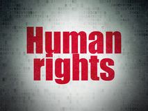 Political concept: Human Rights on Digital Data Paper background. Political concept: Painted red word Human Rights on Digital Data Paper background Royalty Free Stock Photo