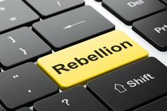 Political concept: Rebellion on computer keyboard background. Political concept: computer keyboard with word Rebellion, selected focus on enter button background Stock Image