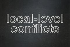 Political concept: Local-level Conflicts on chalkboard background. Political concept: text Local-level Conflicts on Black chalkboard background stock illustration