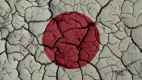 Political Crisis Concept: Mud Cracks With Japan Flag. Political Crisis Or Environmental Concept: Mud Cracks With Japan Flag royalty free stock photography