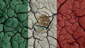 Political Crisis Concept: Mud Cracks With Mexico Flag. Political Crisis Or Environmental Concept: Mud Cracks With Mexico Flag royalty free stock image